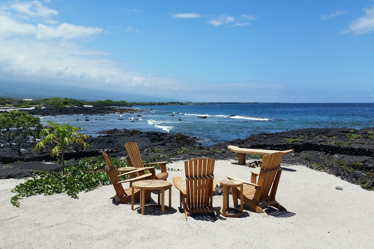 Chairs and table right next to the ocean, provided by Lava Rock Realty